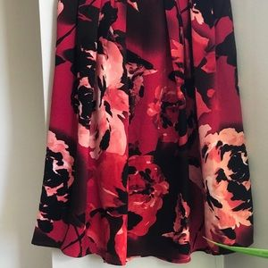 Eve Mendes red circle skirt